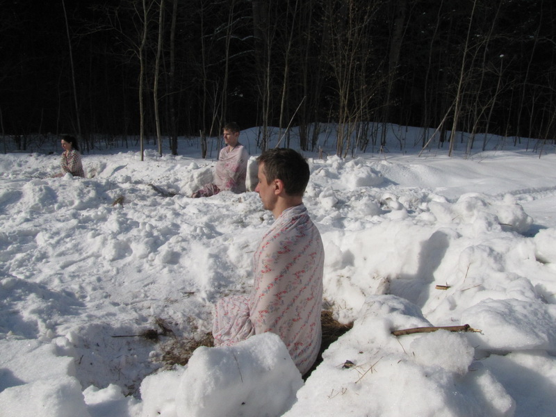 Men & Women performing tummo in snow